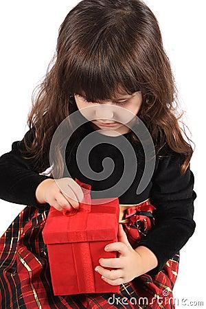 Girl opening present
