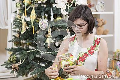 Girl opens Christmas gift