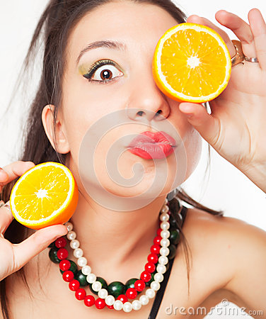 Girl with orange fruit