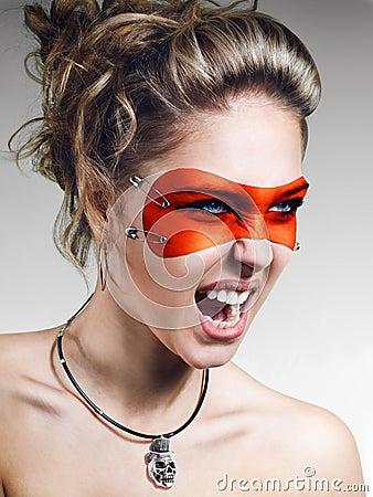 Girl in orange leather mask screaming