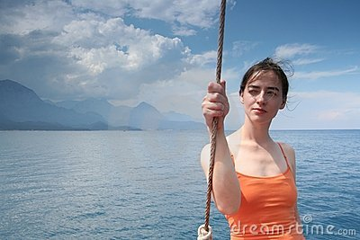 Girl in orange and  the sea