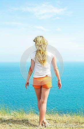 Girl in orange shorts