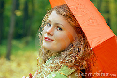 Girl and orange umbrella