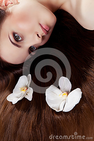 Girl with orchids in hair