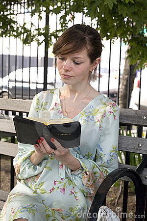Girl outdoors with Bible