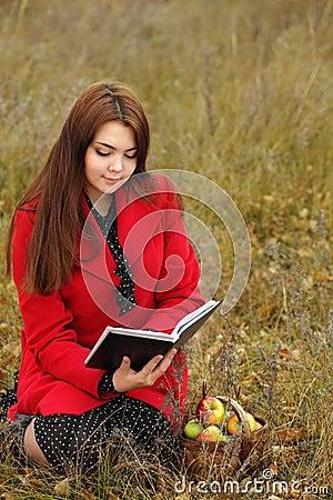 girl outdoors read book