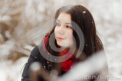 Girl outdoors in snowy winter day