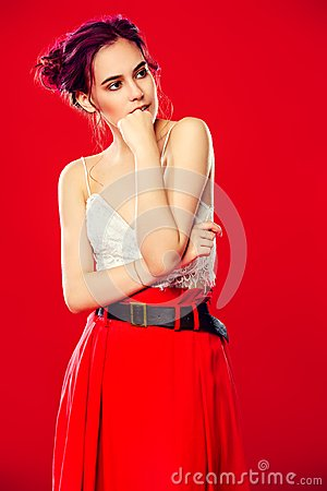 Free Girl Over Red Background Stock Photography - 119664842