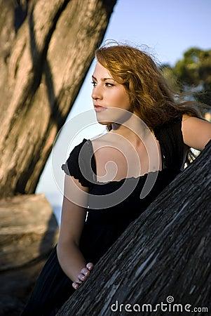 Girl overlooking monterey bay between trees