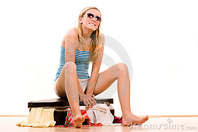 Girl packing full suitcase