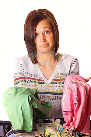 Free Girl Packs Her Clothes Stock Photo - 3327810