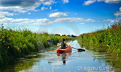 Girl with paddle and kayak