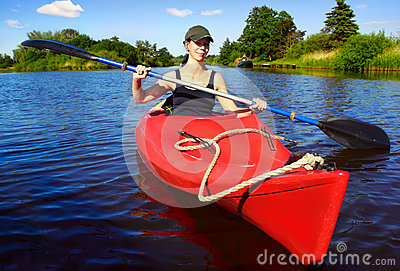 Girl with paddle and kayak 3