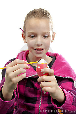 Girl is painting easter egg