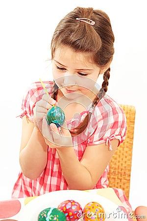 Girl painting egg