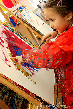Girl painting with her finger