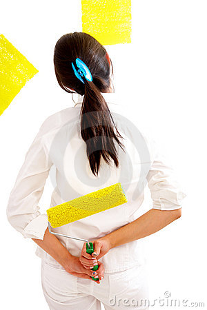 Girl painting in yellow