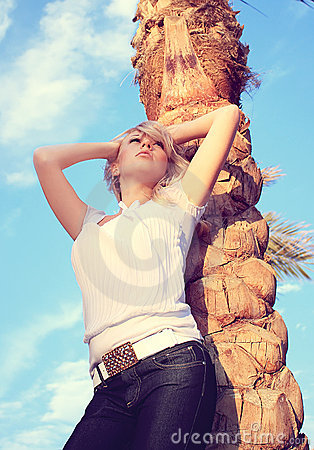 The girl and a palm tree