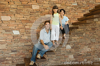 Girl and parents on stairs