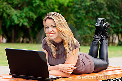 Girl in a park with laptop