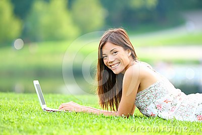 Girl in park on laptop