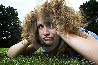 Girl in park making funny face