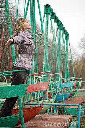 Girl in park on old swing