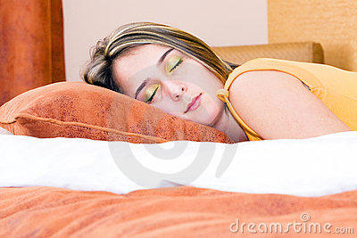 Girl peacefully sleeping in her bed