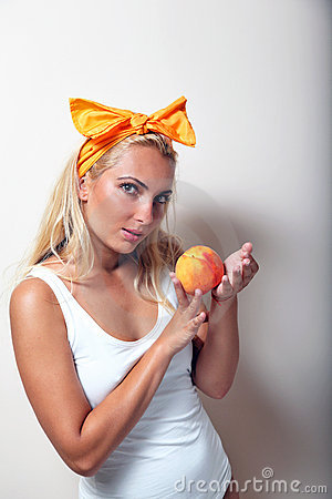 Girl with peach and ribbon.