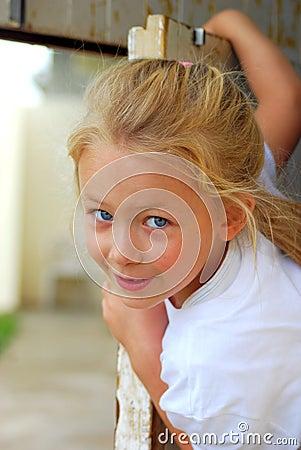Free Girl Peeping Out Door Stock Photos - 13037183