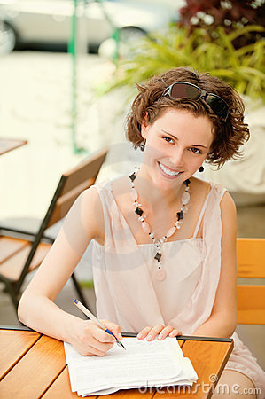 Girl with pen outdoors