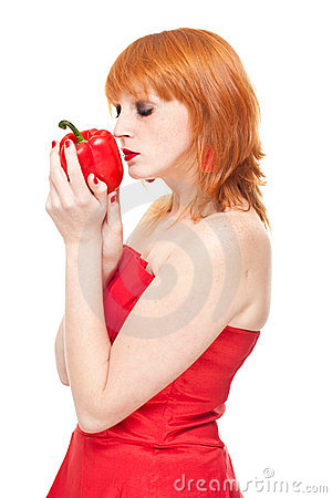 Girl with pepper in red dress isolated