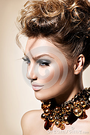 Girl with perfect fashion makeup and hairstyle