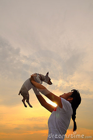 girl and pet dog at sunset