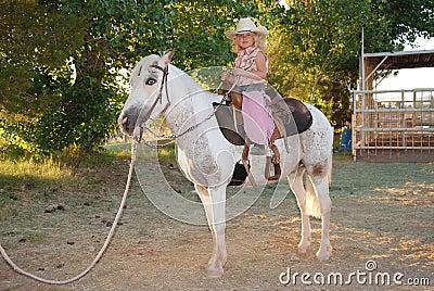 Girl with pet pony.
