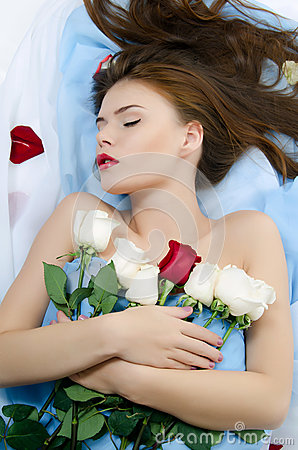 The girl with petals of roses