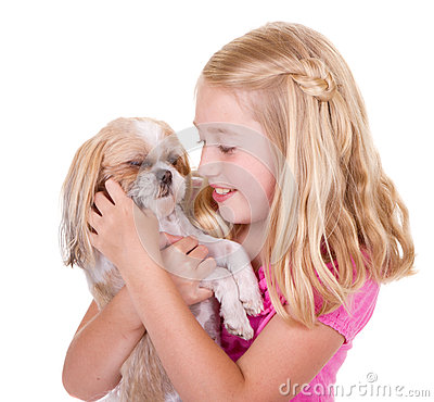 Girl petting her shih tzu dog