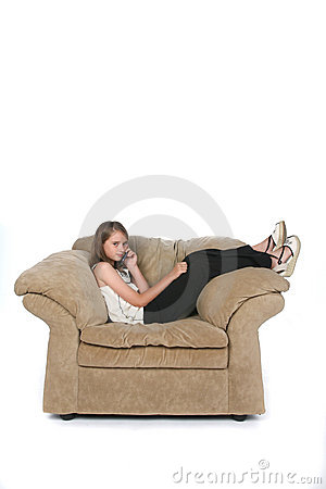 Girl on phone in big chair