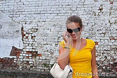 Girl on phone rugged background