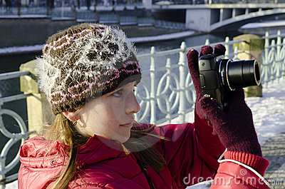 Girl and photo camera
