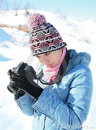 Girl  photographer on  nature in  winter