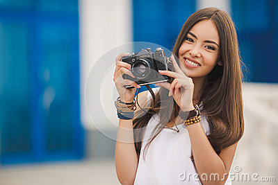 Girl photographer with professional SLR camera