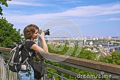 Girl photographer shooting beautiful scenery