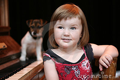 Girl, piano and dog