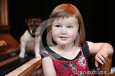 Girl, piano and dog