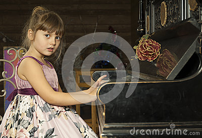 Girl and piano with flower