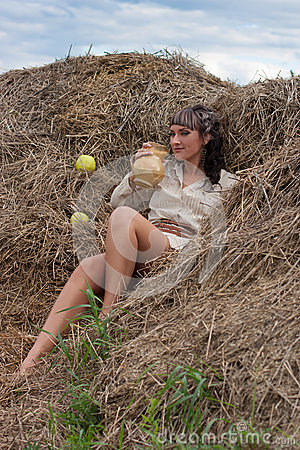 Girl on the pile of hay