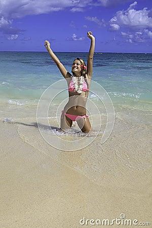 Girl in pink bikini at the beach