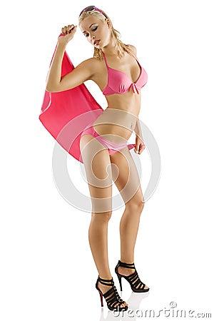 Girl in pink bikini with wet hair