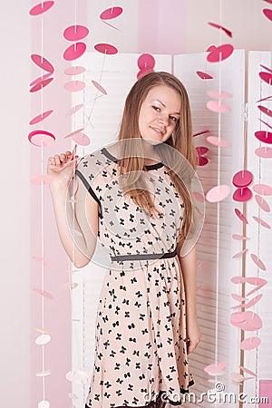 Girl in the pink dress  elegant bedroom
